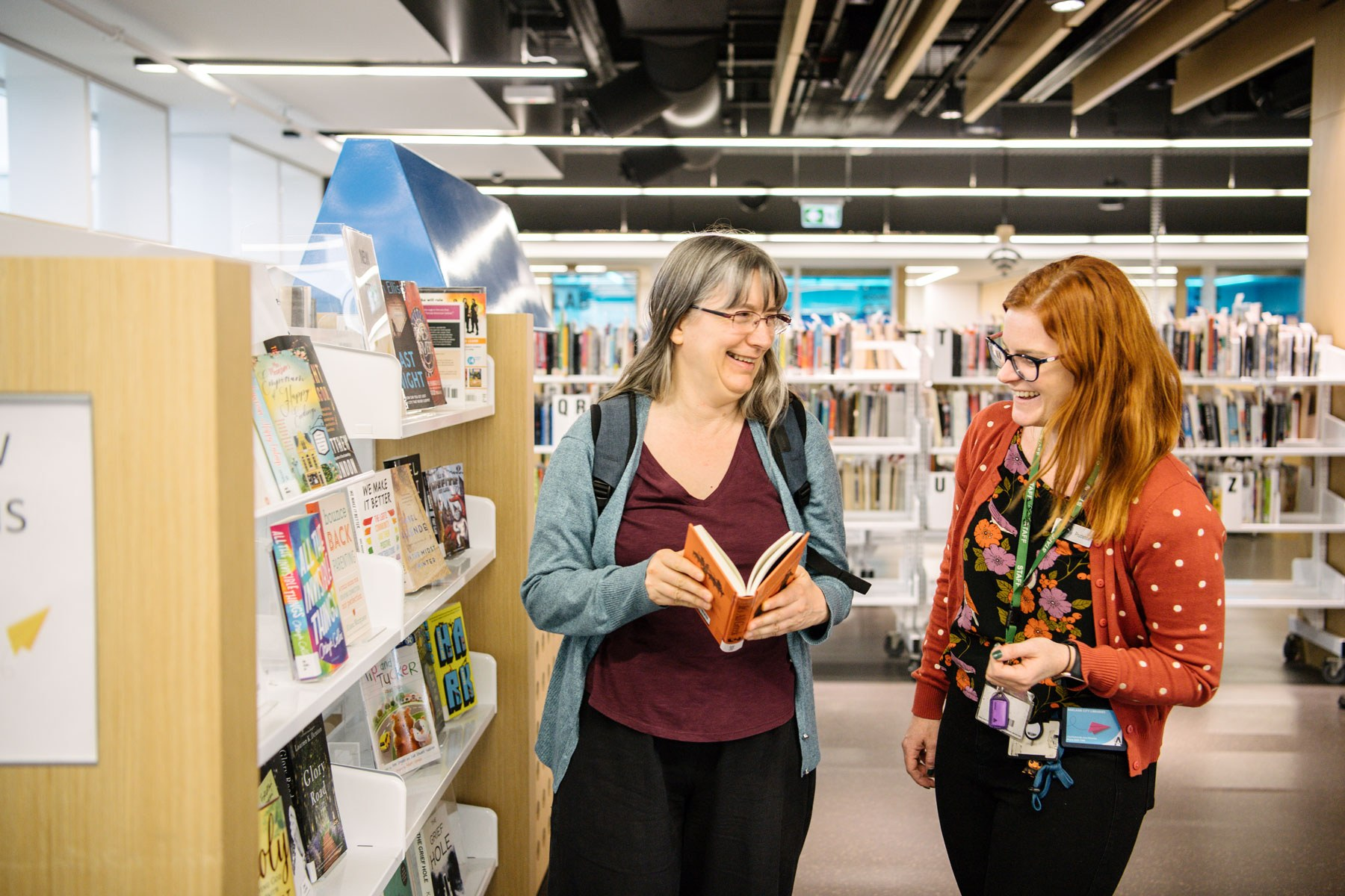 City library user frances with staff member